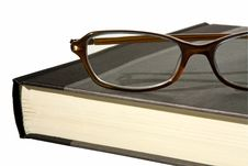 Free Book With A Pair Of Glasses Half View Royalty Free Stock Photography - 8387697