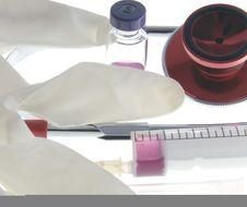 Free Syringe And Latex Gloves Stock Photo - 8388790