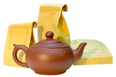 Pottery (clay) Teapot And Tea In Paper Bags. Stock Photography