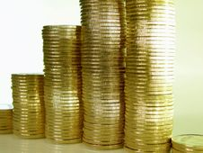 Folded Stack Of Coins In The Form Of Charts Royalty Free Stock Images