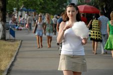 Woman Eating Cotton Candy Royalty Free Stock Photography