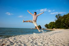 Free Young Man By The Beach Royalty Free Stock Images - 8393359