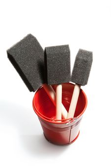 Shiny Red Bucket Contains Paint Brushes. Stock Photography