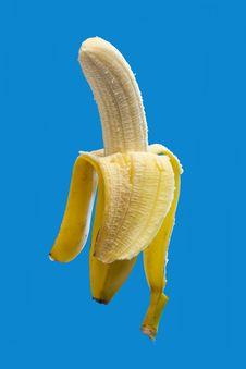 Free Banana On Blue, Half Peeled Stock Photo - 8394760