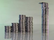 Diagram Consisting Of Piles Of Coins Royalty Free Stock Image
