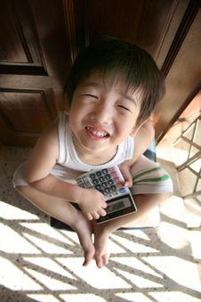Free Boy Holding Calculator Royalty Free Stock Image - 849666