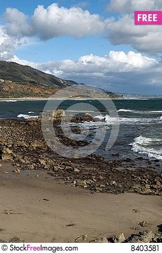Rocky Beach with Sky Stock Photo