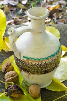 Free Water Pot With Nuts And Leafs Stock Images - 8401074