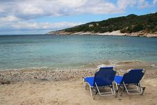 Free Sunbeds On Empty Beach Stock Photos - 8401653