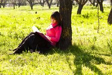 Free Enjoying A Book In The Forest Royalty Free Stock Photos - 8401818
