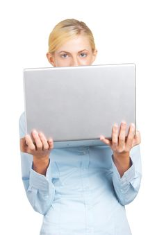Free Woman Looking Over A Laptop Royalty Free Stock Images - 8403149