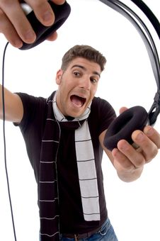 Free Shouting Male Holding Headphone Royalty Free Stock Image - 8406776