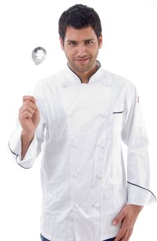 Young Chef Holding Slotted Spoon Royalty Free Stock Photography