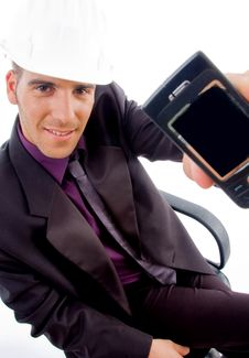 Young Male Architect Showing His Cell Phone Royalty Free Stock Photography