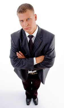 Standing Businessman With Folded Hands Stock Photo