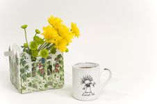 Free Coffee Cup With Yellow Flowers Stock Photo - 8409730