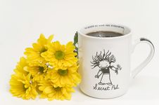 Cup Of Coffee With Yellow Flowers Beside Cup Royalty Free Stock Photography