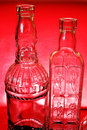 Free Two Bottles On Red Stock Image - 8413661