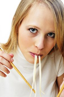 Blond Woman Use Chopsticks Eating Noodles Stock Photography