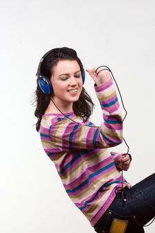 Attractive Young Woman With Headphones Over White Royalty Free Stock Photo