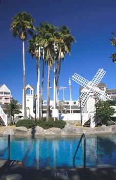 Free Recreational Resort Poolside With White Windmill Stock Photo - 8412590