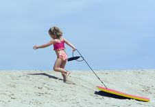 Free Child Running Up Sand Dune Stock Images - 8414914