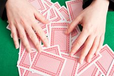 Free Croupier Mixing Cards On A Table Stock Photography - 8415242