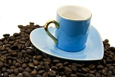 Free Blue Cup And Saucer With Grains Of Coffee Royalty Free Stock Photo - 8415275