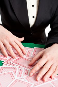 Free Croupier Mixing Cards On A Table Royalty Free Stock Photo - 8415325