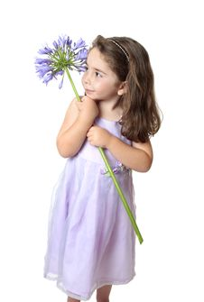 Free Pretty Girl Holding A Flower Stock Photography - 8416932