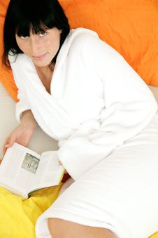 Free Bed Reading Bathrobe Girl Stock Image - 8417881