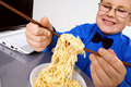 Free Hungry Boy Eating Chinese Noodles With Sticks Royalty Free Stock Image - 8429826
