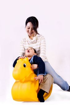 Free Mother And Child Riding Toy Horse Stock Photo - 8425270