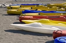 Free Colourful Canoes Lie On Sand Stock Photo - 8426420