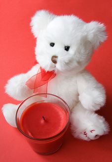 Teddy Bear And Red Candle Stock Photos