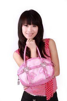 Asian Girl With Pink Handbag Royalty Free Stock Photo