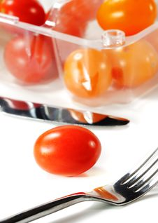 Fork And Knife With Cherry Tomato Stock Photos