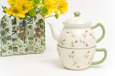 Teapot And Cup With Yellow Flowers Stock Photo