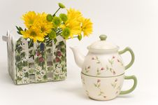 Free Teapot Next To Bouquet Of Yellow Flowers Stock Images - 8428624