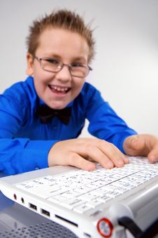 Free Funny School Boy With Laptop Isolated On White Royalty Free Stock Photo - 8429695