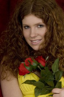 Red Haired Teenager With Red Roses Royalty Free Stock Photo
