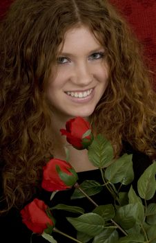Red Haired Teenager With Red Roses Stock Photography