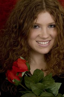 Red Haired Teenager With Red Roses Royalty Free Stock Photos