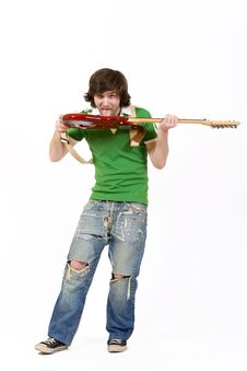 Free Man Biting The Guitar Stock Images - 8431874