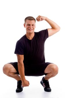 Sitting Muscular Man Showing His Muscles Royalty Free Stock Images