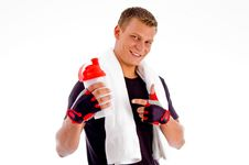 Smiling Muscular Man Pointing At Water Bottle Royalty Free Stock Photos