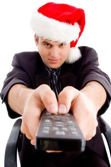 Man Holding Remote Control And Wearing Hat Stock Photography