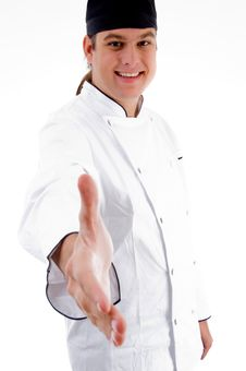 Portrait Of Young Chef Offering Handshake Royalty Free Stock Images