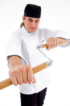 Chef Holding Nunchaku In Fighting Stance Stock Photos