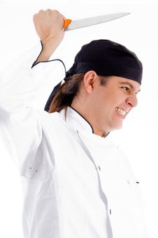 Free Dangerous Young Male Chef With Knife Stock Image - 8433351